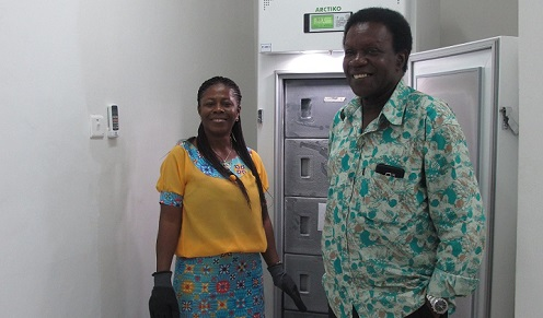 Picture of Two of FOOD's partners in Green Growth, Dr. Margaret Owusu and Dr. Wisdom Amoa at the -80 degrees freezer in the lab, FRI, Accra, Ghana